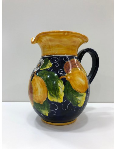 Ceramic jug in lemons background
